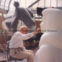 Marshall Fredericks working on the plaster model of the female figure for Star Dream Fountain.tif