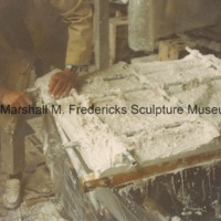Marshall Fredericks works on a plaster model of an unidentified relief in his studio.tif