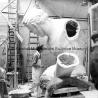 Marshall Fredericks works on the full-scale plaster model of The Spirit of Detroit.jpg