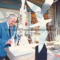 Marshall Fredericks works on the plaster model for Star Dream Fountain in his Royal Oak studio with the maquette for Flying Gulls Fountain in the foreground.tif