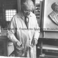 Marshall M. Fredericks examines an unidentified relief in his Royal Oak studio.tif