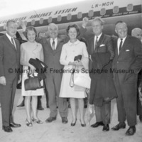 Mrs. Urban Hansen, Urban Hansen, Rosalind Fredericks, Marshall Fredericks and two unidentified men pose beside a Scandinavian Airlines System airplane.jpg