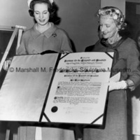Princess Benedikte receives a scroll of gratitude from Mrs. Jeremiah Milbank.jpg