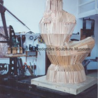 Rear view of armature for Sun Worshipper covered in wooden lathe.tif
