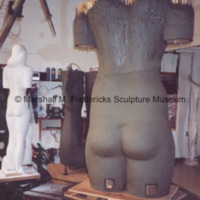 Rear view of the plasteline model of the female figure for Star Dream Fountain with the plaster model in the background.tif
