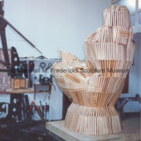 Rearside view of armature for Sun Worshipper covered in wooden lathe.tif