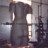 Rearside view of the plasteline model of the female figure for Star Dream Fountain with the plaster model in the background.tif
