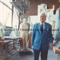 Sculptor Marshall Fredericks surrounded by models of his work in his Royal Oak studio.tif