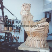Side view of armature for Sun Worshipper covered in wooden lathe.tif