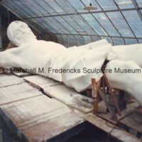 Side view of the damaged full-scale plaster model of Christ on the Cross in the greehouse studio.tif