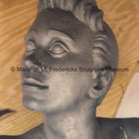 Side view of the head of the youth figure for Youth in the Hands of God.tif