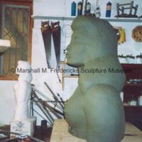 Side view of the plasteline model of the shoulders and head of the female figure for Star Dream Fountain.tif