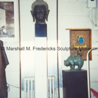 Small-scale bronze The Boy and Bear with other art in Fredericks' Royal Oak studio.tif