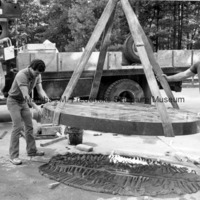 The black granite base for Two Bears is lowered at the Interlochen Center for the Arts.jpg