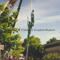 The central figures from Star Dream Fountain are lifted into the air by a crane.tif