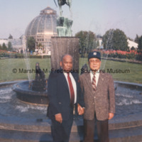 The Deputy Mayor of Detroit and the Mayor of Toyota, Japan pose with the Levi L. Barbour Memorial Fountain on Belle Isle.jpg