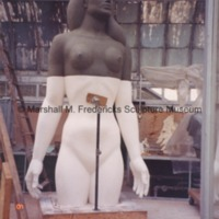 The plasteline model of the female figure for Star Dream Fountain with its lower half covered in plaster.tif