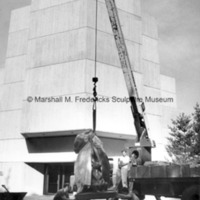 Two Bears is lowered onto the base at Interlochen Center for the Arts.jpg