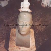 View from above of the plasteline model of the head for the male figure for Star Dream Fountain.tif