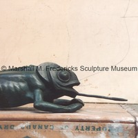 View of bronze Lizard atop a crate.tif