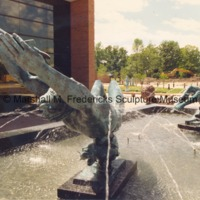 View of bronze Night and Day Fountain with the Sculpture Garden in the background at the Marshall M. Fredericks Sculpture Museum.tif