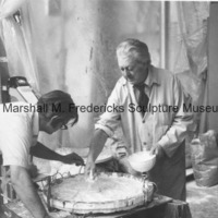 View of Marshall Fredericks and an assistant working on the plaster model for an unidentified medal in the Royal Oak studio2.tif