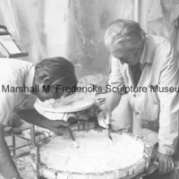View of Marshall Fredericks and an assistant working on the plaster model for an unidentified medal in the Royal Oak studio.tif