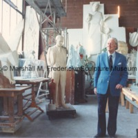 View of Marshall Fredericks in his Royal Oak studio surrounded by plaster models of his work.tif