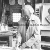 View of Marshall Fredericks in his Royal Oak studio working on an unidentified relief.tif