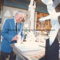 View of Marshall Fredericks works on the plaster model for Star Dream Fountain in his Royal Oak studio with the maquette for Flying Gulls Fountain in the foreground.tif