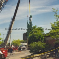 View of the central figures from Star Dream Fountain as they are lifted into the air during their installation.tif