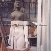 View of the female figure for Star Dream Fountain with its lower half covered in plaster.tif