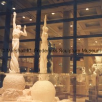 View of the interior of the Marshall M. Fredericks Sculpture Museum reflected in the windows.tif