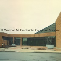 View of the rear entrance to the Arbury Fine Arts Center and the Marshall M. Fredericks Sculpture Museum from the parking lot.tif