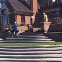 Workers begin to move The Thinker up the steps at a private residence.tif