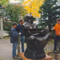 Workers help move the bronze full-scale Sun Worshipper.tif