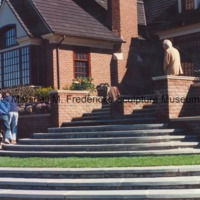 Workers move The Thinker at a private residence.tif