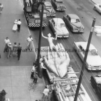 Youth in the Hands of God on a flatbed truck prior to installation.jpg